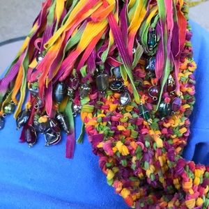 Add color to any bland outfit with this hand knit